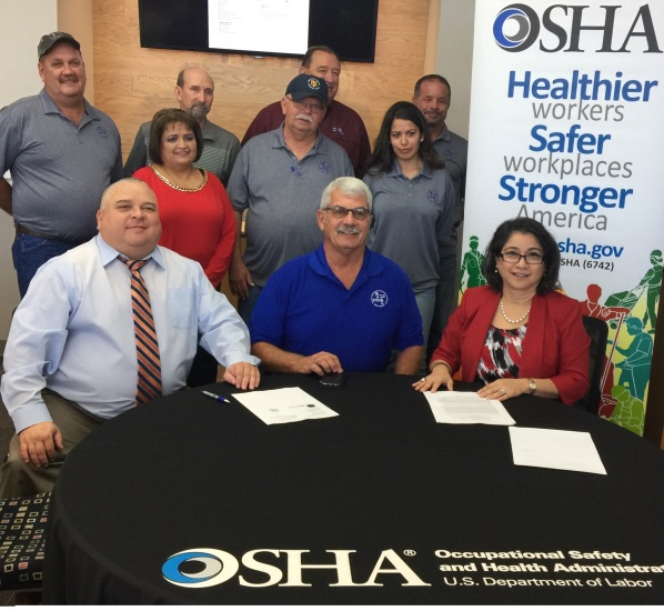 Diego Alvarado, director of OSHA's El Paso Area Office; Elizabeth Linda Routh, director of OSHA's Lubbock Area Office; and Brad Norton, Vice President of the Permian Basin STEPS Network sign alliance to promote oil and gas worker safety