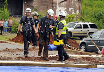 Rescue personnel conclude their search after finding the victim's body.