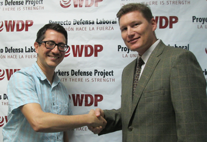 José P. Garza, executive director of the Workers Defense Project, and R. Casey Perkins, OSHA's area director in Austin, sign a two-year alliance renewal agreement at the WDP office in Austin, Texas.