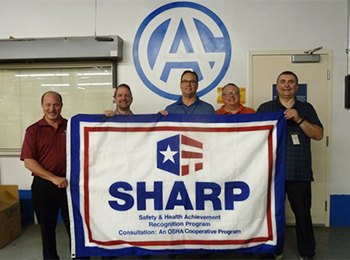 A & A Global Industries holding a SHARP flag