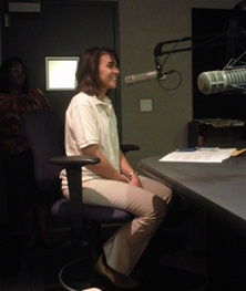 Isabel DeOliveira in a radio broadcasting room