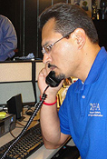 OSHA staff person Mark Hernandez answers a caller's question about OSHA's Heat Illness Campaign.