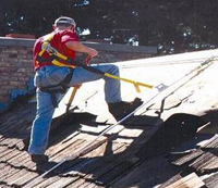 An example of a Personal Fall Arrest System in use during reroofing