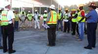 Construction workers in Decatur, Ga., talk about the dangers of heat illness during OSHA's co-sponsored Georgia safety 'stand-down' Aug. 3.