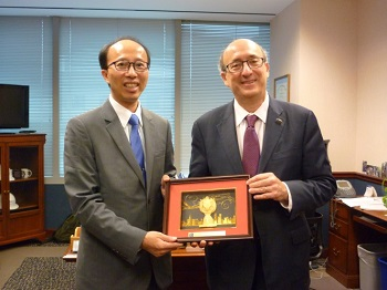 Deputy Chief of Occupational Safety K.F. Lee presents a small customary gift to OSHA Assistant Secretary Dr. David Michaels as a gesture of gratitude for hosting the delegates
