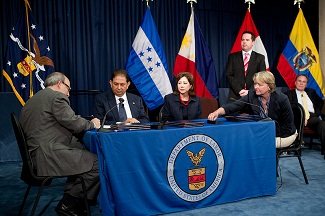 Signing ceremony on Migrant Worker program partnerships, June 11, 2012.  Seated from left: OSHA Assistant Secretary David Michaels,  Ambassador Jorge Ramón Hernández Alcerro of the Government of Honduras, Secretary of Labor Hilda L. Solis and Libby Hendricks of DOL's Wage and Hour Division.