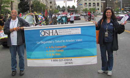 OSHA Compliance Safety and Health Officers Wilson Soto and Clara Marin at the 10th Annual Puerto Rican and Hispanic Day Parade in Buffalo, NY.