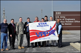 U.S. Army Corps of Engineers Louisville District Office staff holding VPP flag