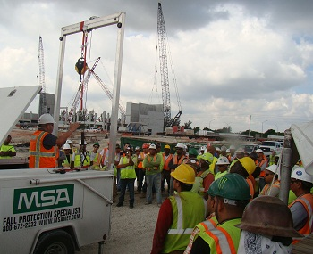 One hundred fifty workers with Balfour Beatty Construction learn about fall prevention at safety stand-down.