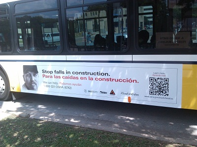 Dallas bus with OSHA fall prevention campaign poster