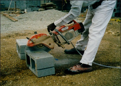 Masonry saw uses water to control silica dust