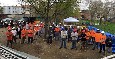 On Tuesday, May 5, 2015, Youth Build Boston, Madison Park High School and the New England Regional Council of Carpenters Training Fund held a two-hour fall safety stand-down that consisted of hands on demonstrations at the construction site of a single family home being built in Roxbury, Mass