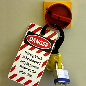 DANGER - This tag & lock to be removed only by person shown on the other side.