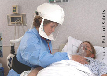Photo of a healthcare worker wearing PAPR