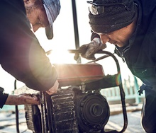 Workers using a portable generator