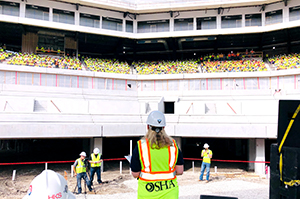 OSHA's Loren Sweatt speaks to more than 1,600 workers at the site of the new Texas Rangers stadium in Arlington, Texas.