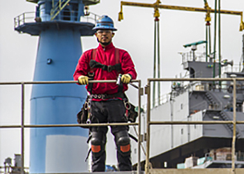 Photo of worker at a shipyard
