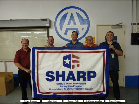 Steve Kovens, John Stup (Maryland Consultation), Dennis Cole, Anthony Jagielski (Maryland Consultation) and Dave Cramer displaying the company's SHARP flag