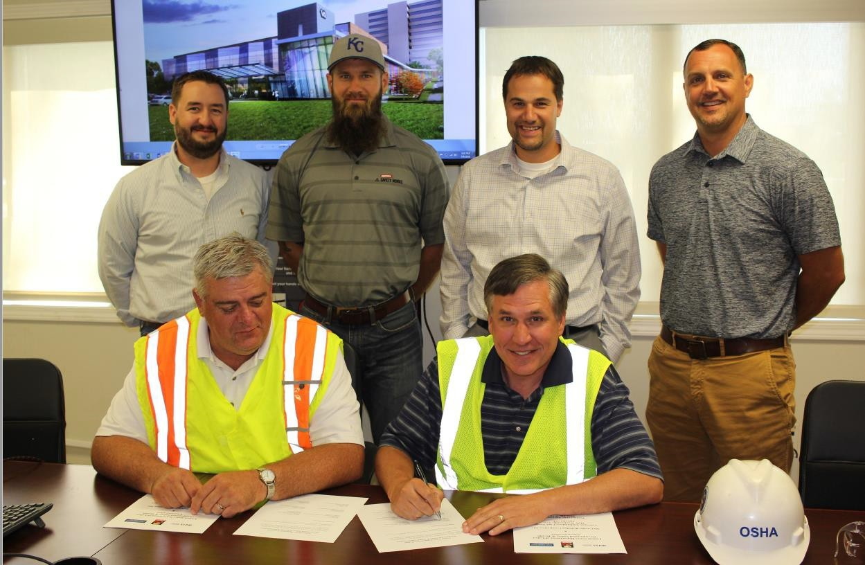 Signing of OSHA Partnership in 2018 (Front) Darwin Craig, Assistant Area Director; Jeff Funke, Area Director (Back) Kris Montgomery, Project Manager; Andy Parrish, Safety Manager; Ryan Sawall, Vice President